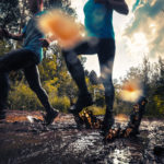 runners doing hard things by running in mud