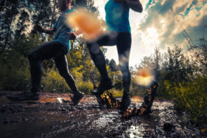 trail runners doing hard things by running through mud