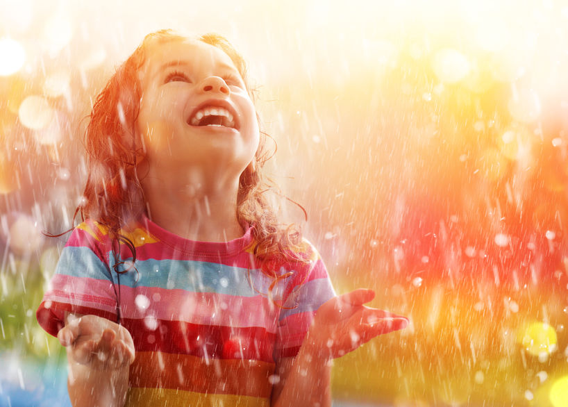 child enjoying moment of grace in rain
