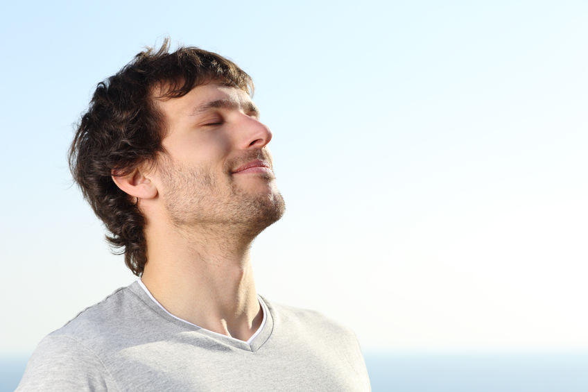 man practicing stillness by taking deep breaths.
