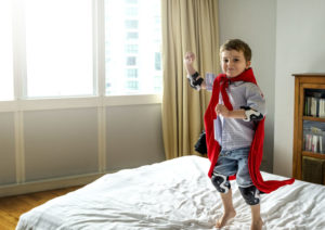boy playing superhero