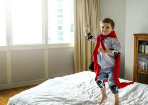 boy playing superhero
