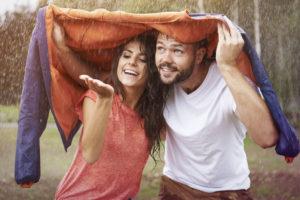 Couple enjoying the rain