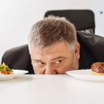 man using willpower to decide what to eat.