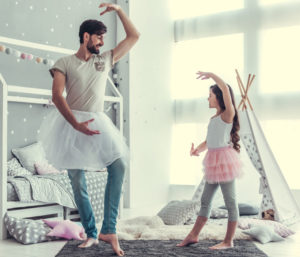 Dad and daughter playing ballerina