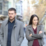 Couple experiencing conflict in marriage walking on a city street
