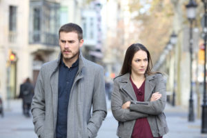 Couple experiencing conflict in their marriage walking on a city street