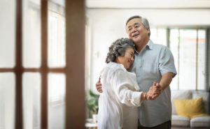 Older couple dancing joyfully because they have overcome the myths of marriage