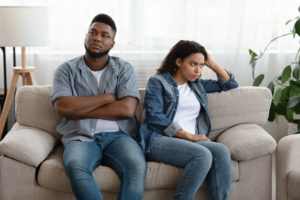 Couple in toxic relationship pattern ignoring each other